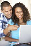 Young Couple Using Laptop Computer At Home Royalty Free Stock Photos