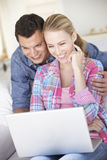 Young Couple Using Laptop Computer At Home Stock Photos