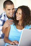 Young Couple Using Laptop Computer At Home Royalty Free Stock Images