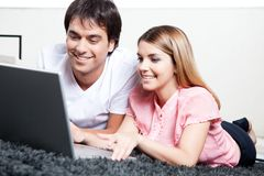 Young Couple Using Laptop Stock Images