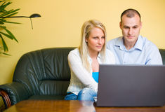 Young couple using laptop at home. Royalty Free Stock Photography