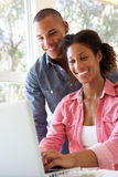 Young Couple Using Laptop At Home Royalty Free Stock Photography