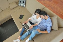 Young couple using laptop at home Stock Photo
