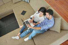 Young couple using laptop at home Royalty Free Stock Images