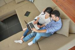 Young couple using laptop at home Royalty Free Stock Image