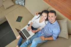 Young couple using laptop at home Stock Images