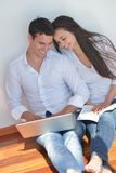 Young couple using laptop at home Stock Photography