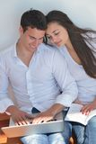 Young couple using laptop at home Stock Photos