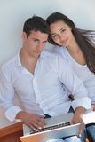 Young couple using laptop at home Royalty Free Stock Photos