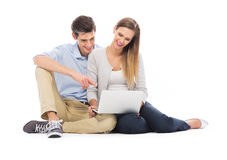 Young couple using laptop Royalty Free Stock Image
