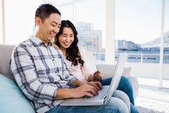 Young couple using laptop Stock Photos