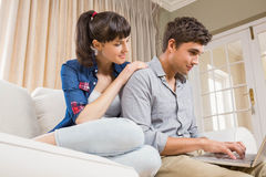 Young couple using a laptop Stock Image