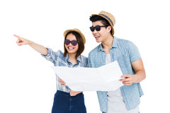 Young couple using map for direction Royalty Free Stock Images