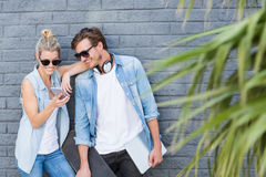 Young couple using mobile phone Stock Photos