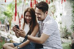 Young couple using a phone together Royalty Free Stock Photos