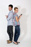 Young couple using phones isolated Stock Photos