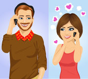 Young couple using smartphone wireless communications Stock Images