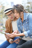 Young couple using smartphones outdoors Stock Photos