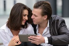 Young couple using tablet Royalty Free Stock Images