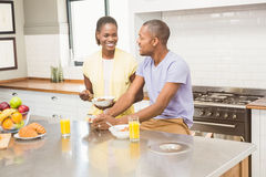 Young couple using tablet at breakfast Stock Photo