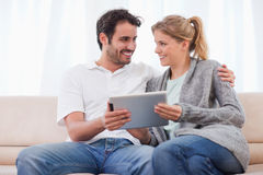 Young couple using a tablet computer Stock Photos