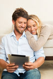 Young couple using tablet computer Royalty Free Stock Images