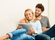 Young couple using tablet computer Stock Photography
