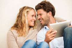 Young couple using tablet computer Stock Image