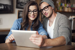 Young couple using tablet stock image