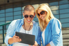 Young couple using  tablet PC Stock Image