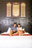 Young couple using a Tablet PC in a asian hotel room Stock Images
