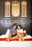 Young couple using a Tablet PC in a asian hotel room Royalty Free Stock Photography