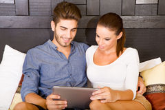 Young couple using a Tablet PC in a asian hotel room Stock Photos