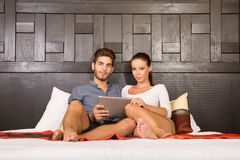 Young couple using a Tablet PC in a asian hotel room Stock Image