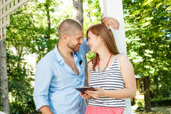 Young couple using a tablet PC in the park Stock Image