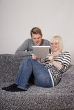 Young couple using tablet pc Royalty Free Stock Photos