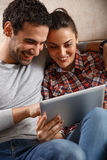 Young couple using tablet Royalty Free Stock Photo