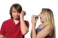 Young Couple Using Tin Can PHone Stock Photo