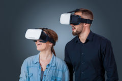 Young couple using a VR headset glasses Royalty Free Stock Images