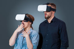 Young couple using a VR headset glasses Stock Image