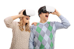 Young couple using VR headsets Royalty Free Stock Image