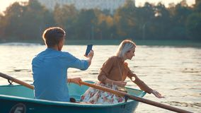 Young couple on vacation. Young couple in a boat Royalty Free Stock Image