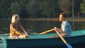 Young couple on vacation. Young couple in a boat on a date on vacation Royalty Free Stock Photo