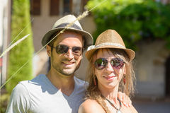 Young couple on vacation. Young couple with hats on vacation Royalty Free Stock Image