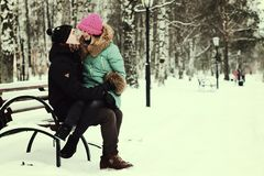 Young couple on vacation. Lover heterosexuals on a date in the winter Royalty Free Stock Photography
