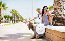 Young couple on vacation on the sea coast. Young couple smiling on the sea coast. Summer vacation Royalty Free Stock Image