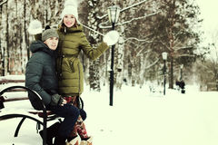 Young couple on vacation. Young student in a winter landscape on a sunny nice day Stock Images