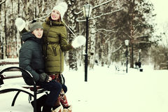 Young couple on vacation. Young student in a winter landscape on a sunny nice day Stock Photo