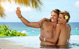 Young couple on vacation taking selfie. Romantic summer Royalty Free Stock Photos