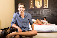 A young couple on vacations enjoying their Hotel room Royalty Free Stock Photography